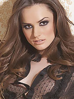 Tori Black posing in a dark set of sexy lingerie