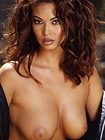 Tera Patrick strips off naked on the motorbike