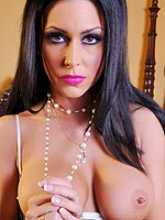 Jessica Jaymes strips naked and teases her snatch