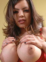 Yurizan Beltran pops her tits out of her red bra