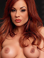 Kirsten Price rams a big dildo up her wet snatch