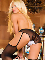 Nicolette Shea seducing in lingerie and stockings