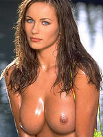 Kyla Cole all oiled up in a bikini stripping outdoors