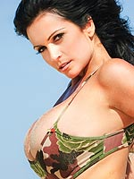 Denise Milani at the beach in a camouflage bikini