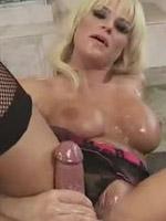 Brooke Belle teases and wanks a huge cock