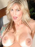 Janine Lindemulder big tits pop out of her dress