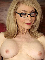 Nina Hartley in lingerie and stockings
