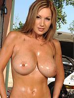 Busty Carol showing her big tits in garage