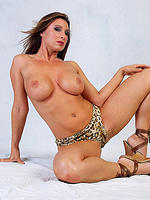Busty MILF Devon Lee poses in leopard skin panties