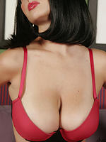 Shay Laren in a black wig busting out of a bra