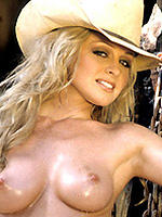 Ashley Roberts poses in a cowgirl costume