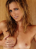 Playmate Deanna Brooks playing guitar in the nude