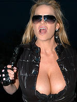 Kelly Madison in black leather wit ha gun