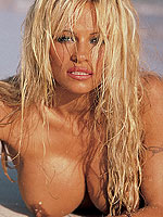 Playmate Pamela Anderson posing naked at the beach