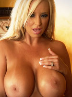 Rachel Aziani strips off her sexy pink lingerie