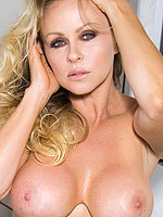 Dyanna Lauren opens her shirt to release her tits