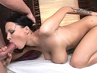 Busty Dominno has her pussy probed with glass rod and sucking dick