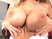 Busty beauty masturbates