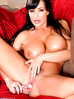 Lisa Ann posing on her giant comfy couch