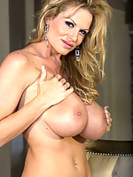 Kelly Madison shows her big tits